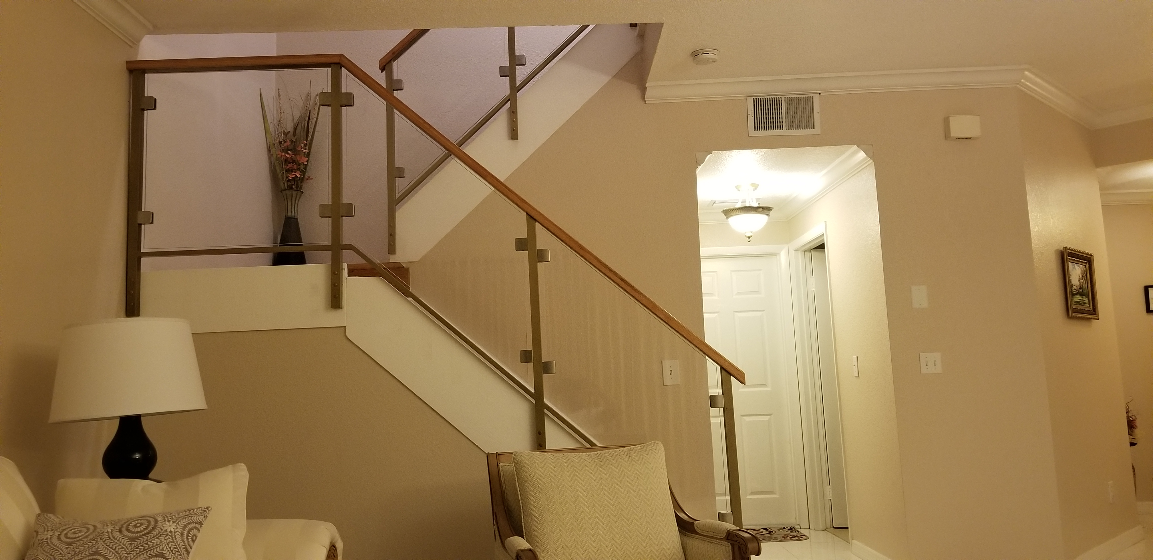 glass staircase railings with wooden handle